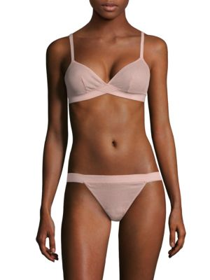 Image of Adjustable cotton bralette with rib-knit details. Adjustable straps. Back hook-and-eye closure. Cotton. Hand wash. Made in USA. Please note: Bikini bottom sold separately.
