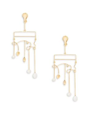 Image of Artfully twisted wire earring with luminous pearl drops. White baroque freshwater pearls. Dipped in 18K yellow gold. Post back. Made in France.