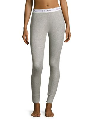 Image of Leggings in knit construction with brand logo at waist. Elasticized logo waistband. Elasticized cuffs. Modal/elastane/polyester. Hand wash. Imported.