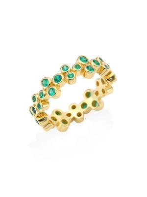 Image of Bezel-set emerald clusters compose stackable band. Emerald.18K yellow gold. Imported.