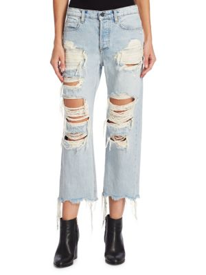 """Image of Bleached cotton jeans with frayed details. Belt loops. Button closure. Five-pocket style. Inseam, about 9"""".Cotton. Dry clean. Made in USA of imported fabric. Model shown is 5'10"""" (177cm) wearing US size 4."""