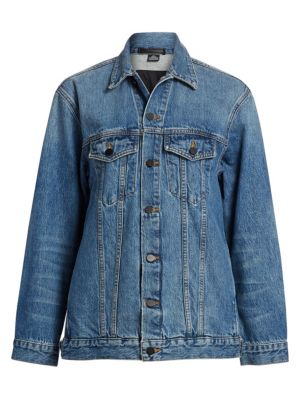 """Image of Adventurous style in a trendy oversized fit denim jacket. Spread collar. Long sleeves. Button front. Chest buttoned flap pockets. About 27"""" from shoulder to hem. Cotton. Dry clean. Made in USA. Model shown is 5'10"""" (177cm) wearing size Small."""