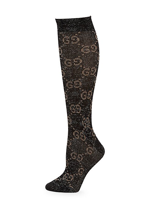 Image of Calf and ankle socks continue to be an important part of Gucci's design aesthetic. Made from a shiny lurex and cotton blend, these socks feature the interlocking G motif-a nearly 100-year-old symbol that has been brought back into the forefront of Gucci's