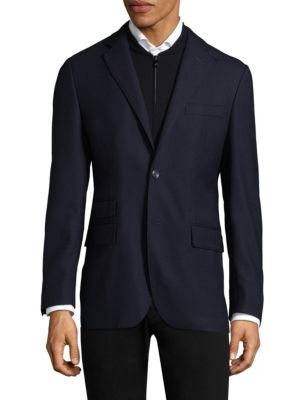 Image of Wool sportcoat featuring classic notch lapels. Notch lapels. Long sleeves. Buttoned cuffs. Button front. Chest welt pocket. Waist flap pockets. Dual back vents. Wool. Dry clean. Made in Italy.