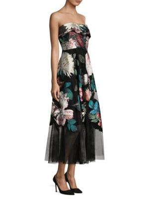 """Image of Strapless mini dress in artful multicolored floral-print. Straight across neckline. Strapless. Concealed back zip. About 54"""" from top to hem. Polyester/nylon. Dry clean. Made in Italy. Model shown is 5'10"""" (177cm) wearing US size 4."""