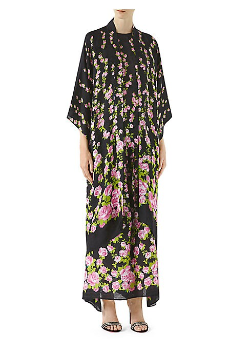 """Image of Allover roses print elevates this kimono. Shawl collar. Long kimono sleeves. Open front. About 60"""" from shoulder to hem. Viscose/silk. Dry clean. Made in Italy. Model shown is 5'10"""" (177cm) wearing US size 4."""