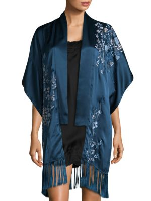 "Image of Silk cardigan featuring fringe details at hem. Open front. Caftan sleeves. Fringed hem. About 32"" from shoulder to hem. Silk. Dry clean. Imported."