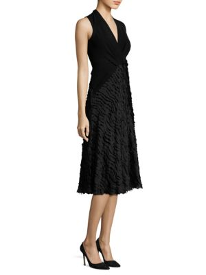 """Image of Fringe trimmed wrap dress in chevron pattern. Deep V-neck. Sleeveless. Concealed back zip. About 45"""" from shoulder to hem. Polyester/cotton/polyamide. Dry clean. Made in Italy. Model shown is 5'10"""" (177cm) wearing US size 4."""