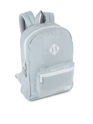"Image of Backpack features logo brand patch detail. Top handle. Adjustable shoulder straps. Top zip closure.13"" laptop sleeve. Inside media pocket. One outside zip pocket. Lined. Reflective coated polyester blend.10.5""W x 15.5""H x 4.5""D.Spot clean. Imported."