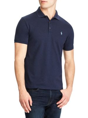 """Image of This Classic Fit Polo shirt is infused with extra stretch for a great fit-and an even greater ease of movement. Spread collar. Short sleeves with ribbed armbands. Three-button placket. Signature embroidered pony at left chest. Even vented hem. About 29"""" f"""
