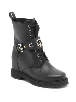"Image of Edgy leather combat boots set on concealed wedge heel. Hidden wedge heel, 3.34"" (85 mm).Leather upper. Round toe. Lace-up vamp. Adjustable buckle and side zip closure. Leather lining. Rubber lug sole. Made in Italy."
