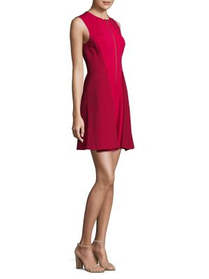"""Image of .A-line mini dress with pleated details at skirt. .Roundneck. .Sleeveless. .Exposed front zip. .Lined. .About 35"""" from shoulder to hem. .Rayon/nylon. .Dry clean. .Imported. .Model shown is 5'10"""" (177cm) wearing US size 4. ."""