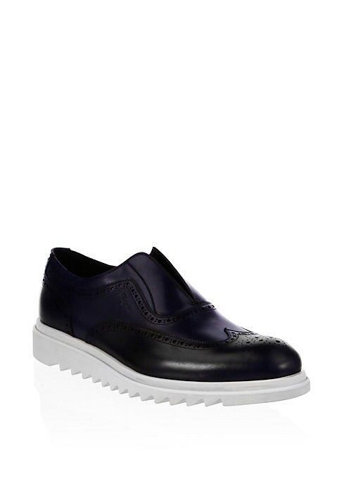Image of Leather loafers with classic brogue detail. Leather upper. Almond toe. Slip-on style. Leather lining. Rubber sole. Made in Italy.
