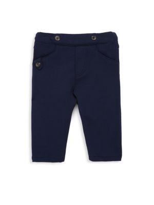 Image of Pants with button detail at waist and pockets. Elasticized waist. Front slit pockets. Back welt pocket. Viscose/nylon/elastane. Machine wash. Imported.
