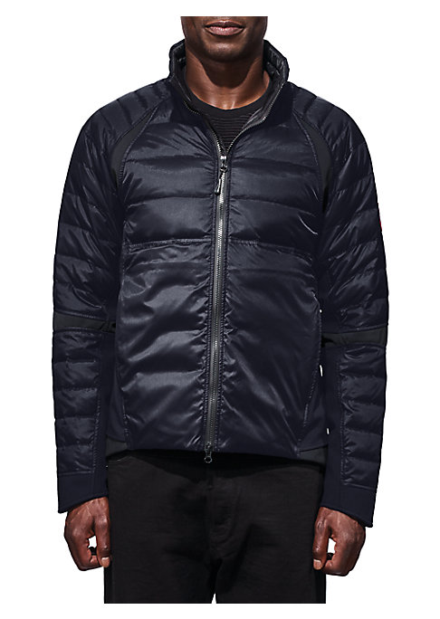Image of Classic jacket with allover quilted design. Stand collar. Long sleeves. Exposed front zip. Side slip pockets. Hi-lo hem. Nylon. Fill: Duck down/feather. Machine wash. Made in Canada.