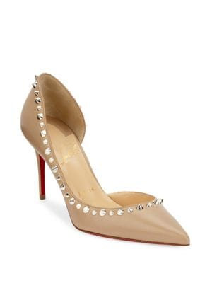 "Image of Smooth leather d'Orsay pump trimmed with spiked studs. Self-covered heel, 3.34"" (85mm).Nappa leather upper. Point toe. Leather lining. Signature red leather sole. Made in Italy."
