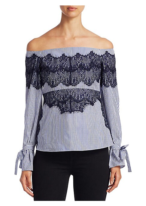 """Image of Blazing bell-sleeve cotton top with shirred details on back. Off-the-shoulder neckline. Long bell sleeves. Self-tie at cuffs. About 20"""" from shoulder to hem. Cotton. Dry clean. Imported. Model shown is 5'10"""" (177cm) wearing US size 4."""
