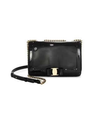 "Image of Classic Vara bow accents glossy patent crossbody. Chain and patent leather crossbody strap, 11-22"" drop. Push-lock closure. Goldtone hardware. One inside slip pocket. One inside zip pocket. Contrast leather lining. Includes dustbag and authenticity card.9"