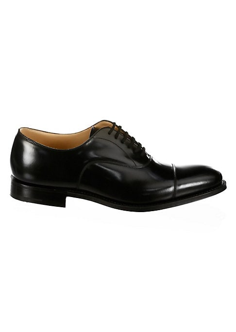 Image of .Polished leather oxfords with a glossy finish. .Leather upper. .Cap toe. .Lace-up vamp. .Leather lining and sole. .Made in UK. .