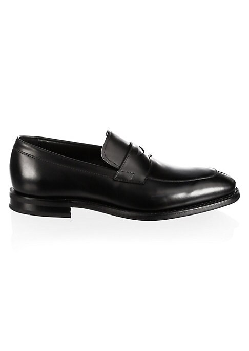 Image of .Leather penny loafers featuring strap detail at vamp. .Leather upper. .Almond toe. .Slip-on style. .Leather lining. .Leather/textile sole. .Made in UK. .