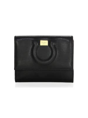 Image of .Organize your coins, bills and cards with this leather wallet. .Flap snap button closure. .Leather trim. .Goldtone hardware. .One exterior coin pocket. .One interior bill compartment. .Six interior credit card slots. .Leather lining. .Includes authentici