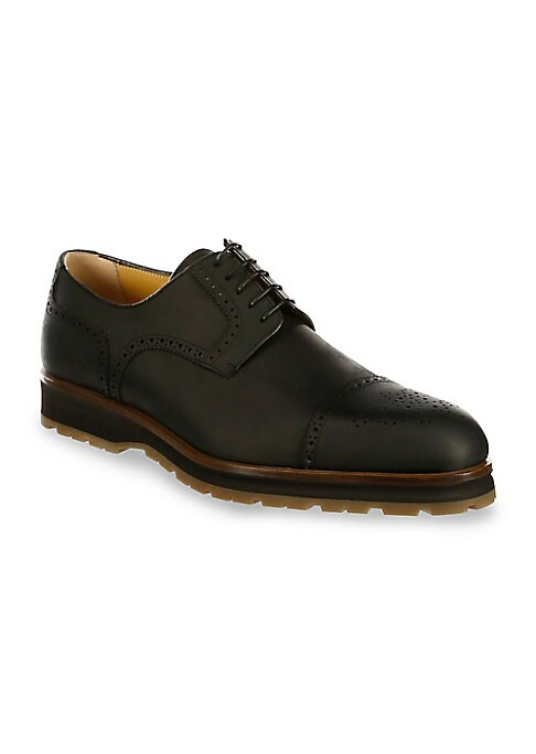 Image of Classic brogue detail styles leather derby shoe. Leather upper. Cap toe. Lace-up vamp. Leather lining. Rubber sole. Made in Italy.