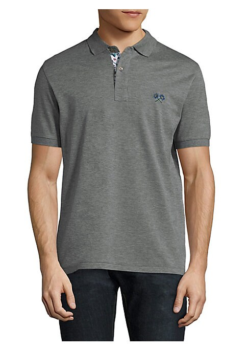 Image of Cotton polo with embroidered detail at chest. Polo collar. Short sleeves. Rib-knit cuffs. Two-button placket. Cotton. Machine wash. Imported.