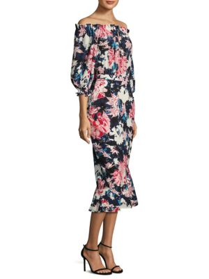 "Image of Floral silk dress with a fitted silhouette. Off-the-shoulder neckline. Three-quarter sleeves. Elastic ruffle cuffs. Button closure at back keyhole. Concealed back zip. Asymmetrical hem. About 45"" from shoulder to hem. Silk. Dry clean. Imported. Model show"