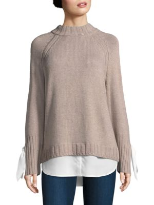 """Image of Cashmere-blend pullover with woven tie at cuffs. High neck. Long raglan sleeve. Rib-knit at neck, cuffs and hem. Woven along hemline. About 28"""" from shoulder to hem. Cashmere/wool/cotton/viscose/nylon/polyester. Dry clean. Imported. Model shown is 5'10"""" ("""