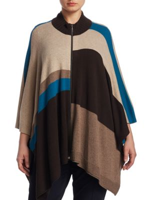 """Image of Geometric wool-blend poncho featuring caftan sleeves. Stand collar. Caftan sleeves. Exposed front zip. Asymmetrical hem. About 26"""" from shoulder to hem. Virgin wool/viscose/polyamide/cashmere. Hand wash. Imported."""