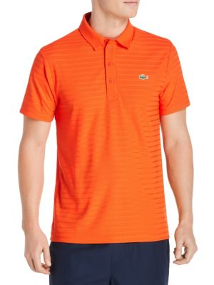 Image of Classic-style polo featuring logo detail at chest. Polo collar. Short sleeves. Four-button placket. Polyester. Machine wash. Imported.