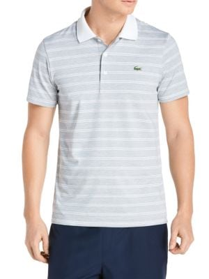 Image of Classic-style polo featuring logo detail at chest. Polo collar. Short sleeves. Three-button placket. Slit detail at sides. Polyester/elastane. Machine wash. Imported.