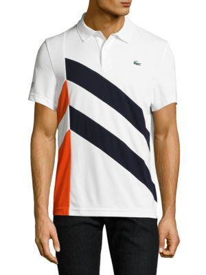 Image of Textured polo with logo detail at sleeve and chest. Polo collar. Short sleeves. Two-button placket. Polyester. Machine wash. Imported.