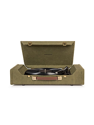 Image of Not all who wander are lost, and the Nomad certainly isn't. Go on a musical journey with this portable three-speed turntable, with its mid-century style wrapped in rugged fabric. Built-in speakers will share music with fellow travelers or headphone jacks