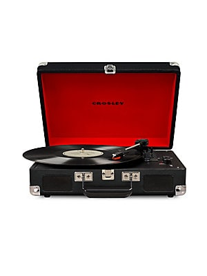 Image of From the Cruiser Deluxe Collection. Crosley's most popular turntable, the Cruiser, just got an upgrade. Introducing the Crosley Cruiser Deluxe! This record player still rocks its charming suitcase-style shell, but now you can dial in the record's speed wi