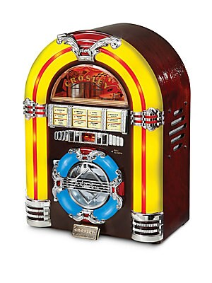 Image of Perfect addition to your vintage-themed decor, this jukebox CD player features color-shifting LEDs that exude the perfect nostalgic appeal. Not only does it work as CD player, it also functions as AM/FM radio and accepts audio devices through the auxiliar