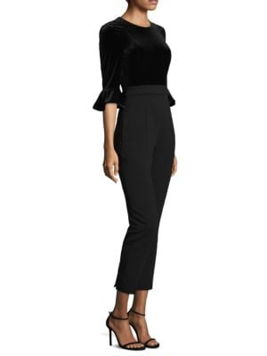 "Image of Cropped jumpsuit featuring ruffled cuffs design. Jewel neckline. Three-quarter sleeves. Ruffled cuffs. Concealed back zip closure. Tapered leg. Inseam, about 28"".Lined. Polyamide/elastane/viscose. Dry clean. Imported. Model shown is 5'10"" (177cm) wearing"
