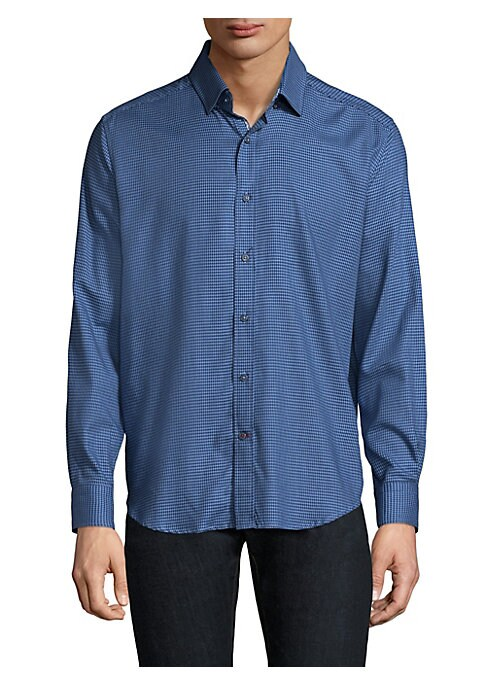Image of Cotton button-down shirt featuring houndstooth design. Spread collar. Long sleeves. Buttoned barrel cuffs. Button front. Curved hem. Regular-fit. Cotton. Machine wash. Imported.