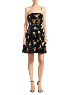 """Image of Elegant flare dress with allover floral design. Squareneck. Spaghetti strap. Sleeveless. Exposed back zip. Laced hem. Lined. About 34"""" from shoulder to hem. Polyester/silk. Dry clean. Imported. Model shown is 5'10"""" (177cm) wearing US size 4."""