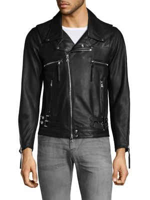 Image of Overlay shoulder and strap waist leather jacket. Notch lapels. Long sleeves. Zippered cuffs. Exposed front zip. Chest zip pockets. Waist zip pockets. Leather. Dry clean by leather specialist. Made in USA.