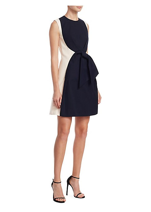 """Image of Bow accented cotton dress in bold colorblock style. Roundneck. Sleeveless. Concealed back zip. About 34"""" from shoulder to hem. Cotton. Dry clean. Imported. Model shown is 5'10"""" (177cm) wearing US size 4."""