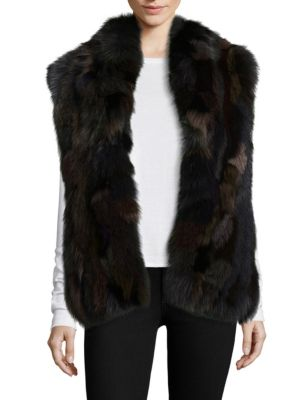 """Image of Multicolor fox fur shapes luxurious wide-cut vest. Shawl collar. Sleeveless. Concealed hook-and-eye closure. Lined. About 24"""" from shoulder to hem. Polyester. Fur type: Dyed fox. Fur origin: China. Dry clean by fur specialist. Imported."""