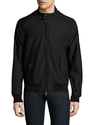 Image of Raglan sleeve jacket accented with back storm flap. Stand collar with button closure. Long raglan sleeves. Rib-knit cuffs and hem. Concealed front zip. Front button flap pockets. Back storm flap. Polyester/elastane. Machine wash. Made in Italy.
