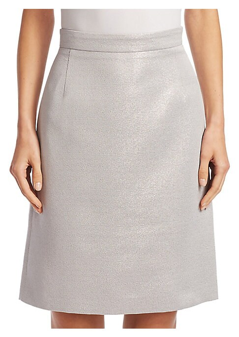 """Image of A-line skirt in a shimmering metallic finish. Banded waist. Concealed back zip. About 25"""" long. Cotton/polyester. Dry clean. Imported. Model shown is 5'10"""" (177cm) wearing US size 4."""