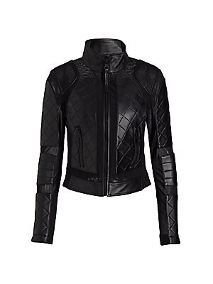 "Image of Jacket with lace-up details and quilted leather Stand collar Long sleeves with side zips Thumbhole cuffs Exposed front zip Waist zip pockets Back lace-up details on side Back exposed seams on layered hem Lined About 17"" from shoulder to hem Leather Dry cl"