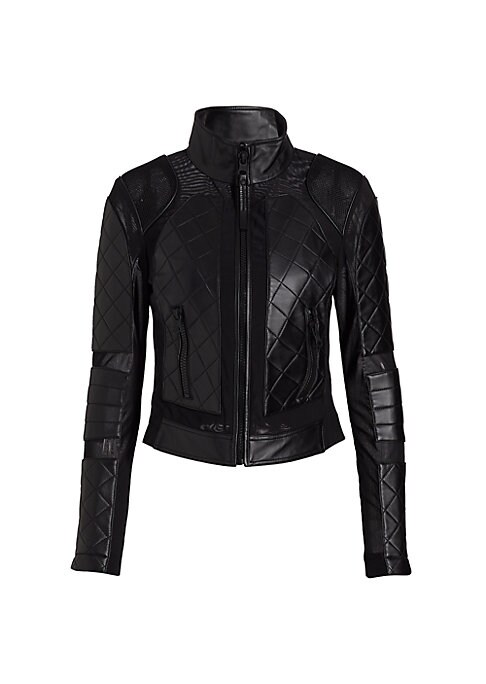 "Image of Jacket with lace-up details and quilted leather. Stand collar. Long sleeves with side zips. Thumbhole cuffs. Exposed front zip. Waist zip pockets. Back lace-up details on side. Back exposed seams on layered hem. Lined. About 17"" from shoulder to hem. Leat"