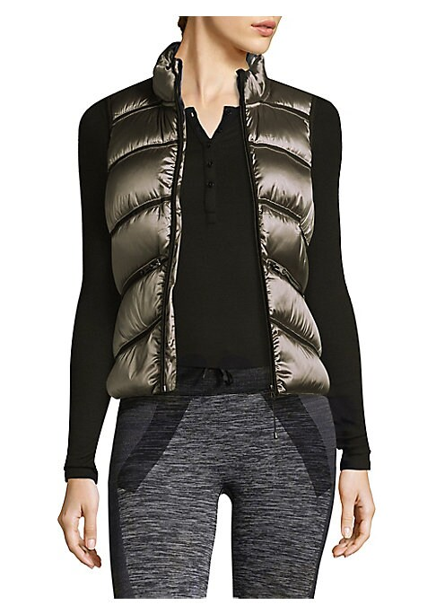 """Image of Quilted puffer vest with contrast mesh insets. Stand collar. Sleeveless. Exposed front zip. Front zip pockets. About 22"""" from shoulder to hem. Polyester/nylon. Machine wash. Imported. Model shown is 5'10"""" (177cm) wearing size Small."""