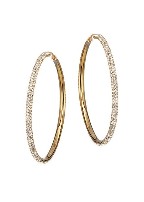 "Image of .EXCLUSIVELY AT SAKS FIFTH AVENUE. High-shine crystals cover large statement hoops. Glass crystals. Rhodium plated brass. Width, about 2"".Hinge back. Imported."