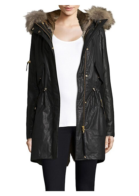 """Image of .Classic parka in fur trim detail. Adjustable hood with fur trim. Long sleeves. Concealed front zip with snap buttons. Drawstring waist. Chest snap-flap pockets. Includes removable vest. Lined. About 35"""" from shoulder to hem. Cotton/polyurethane. Lining:"""
