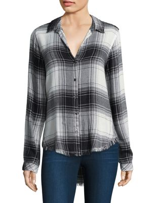 """Image of Button-down long sleeve shirt with plaid design. Spread collar. Long sleeves. Buttoned cuffs. Front button closure. Back vent. Frayed hi-lo hem. About 26"""" from shoulder to hem. Rayon/acrylic. Machine wash. Imported. Model shown is 5'10"""" (177cm) wearing US"""